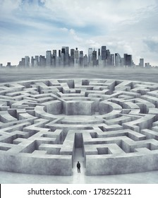Businessman in maze and city on horizon