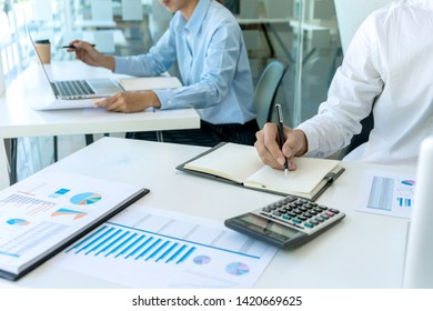 businessman in meeting analysis chart graphy marketing plan in business financial  audit project. Or Business adviser analyzing Budget.