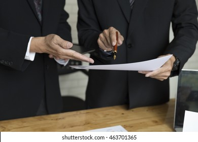 businessman meeting, analyzing and discussing with laptop computer and paperwork document