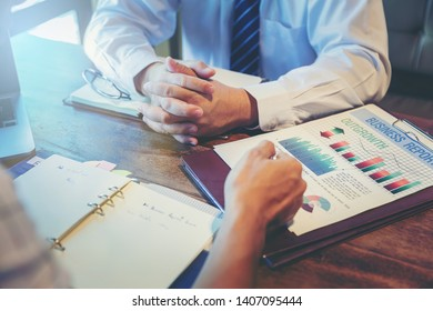 Businessman meeting to discuss the situation on the market. Analyzing business data. Selected focus