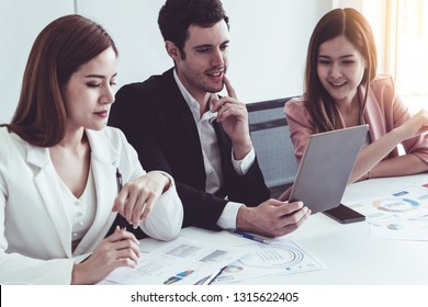 Businessman is in meeting discussion with colleague businesswomen in modern workplace office. People corporate business team concept.