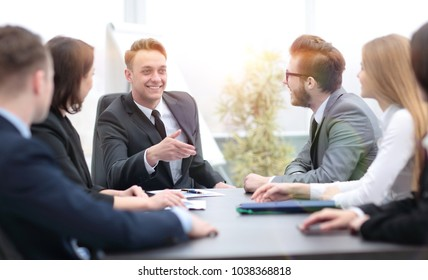 businessman at a meeting with employees