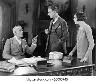 Businessman meeting with man and woman