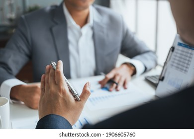 Businessman meeting and working with financial report, talking about business plan for investment, finance analysis concept