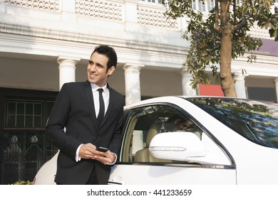 Businessman with a mobile phone INDIA DELHI