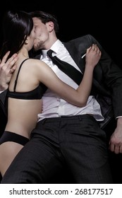 Businessman and model couple kissing each other