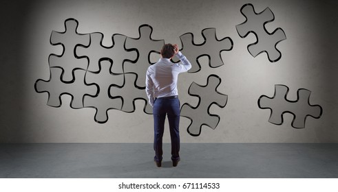 Businessman in modern interior searching puzzle solution on a wall 3D rendering