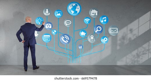 Businessman in modern interior using social network interface on a wall 3D rendering