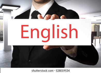 businessman in modern office holding sign english