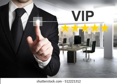 businessman in modern office pushing button vip