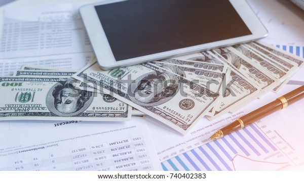 Businessman with money in hand, US dollar,investment, success and profitable business concepts.