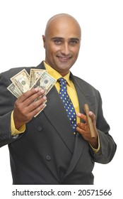 Businessman with money isolated against a white background