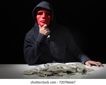Businessman with money and mask.