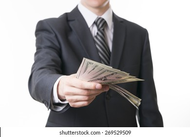 Businessman with money in studio on a white background