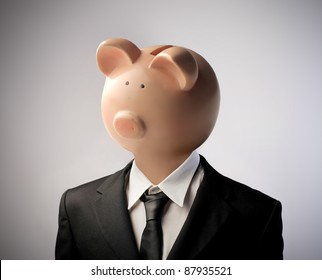 Businessman with moneybox instead of his head