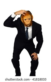 businessman with a monkey mask and hand scratching his head