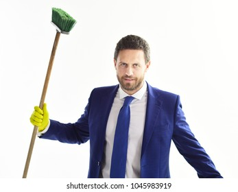 Businessman with mop. Bearded man in formal suit with serious face and sweep. Banker, manager or director holds cleaning supplies. Housework, cleaning service concept. Money, fraud, corruption.