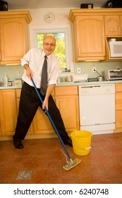 Businessman mopping kitchen floor