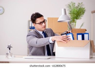 Businessman moving offices after promotion