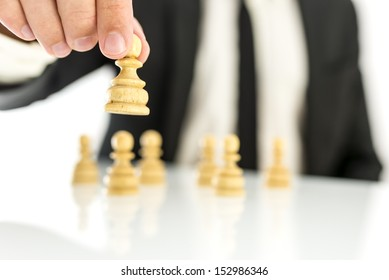 Businessman moving pawn chess figures. Concept of business strategy.
