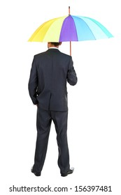 Businessman with multicolor umbrella, isolated on white
