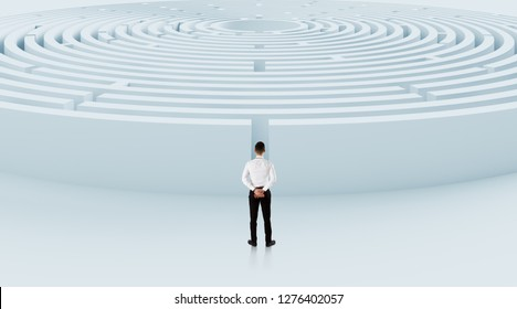Businessman navigating through a maze. Concept of business challenge