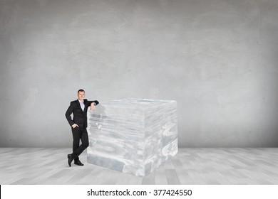 Businessman near big ice cube