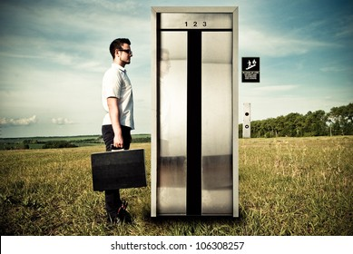 businessman near the elevator on the nature