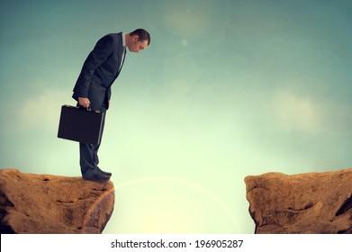 businessman nervously facing an obstacle challenge