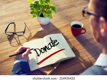 Businessman with Note About Donate Concepts