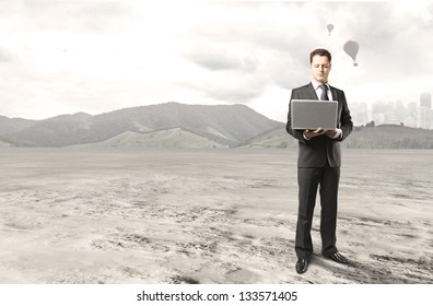 businessman with notebook on nature background