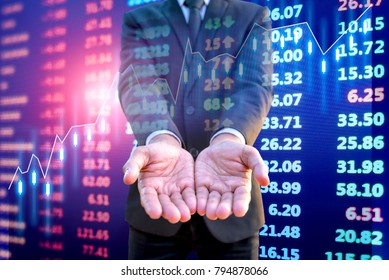 Businessman offer business benefit with stock market electronic board background
