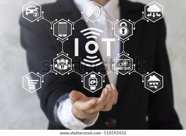 Businessman offer iot icon with wireless symbol and tech devices network. Internet of things concept. IoT solution represent, symbol connected. Intelligent house, car, laptop, watch, smartphone