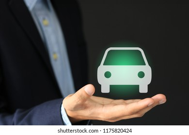 Businessman with offering gesture and icon of car insurance and services concept.
