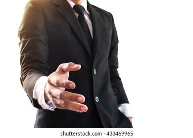 Businessman offering for handshake on office