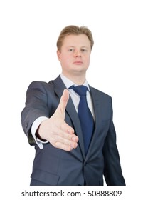 Businessman offering a handshake over white, Focus on hand