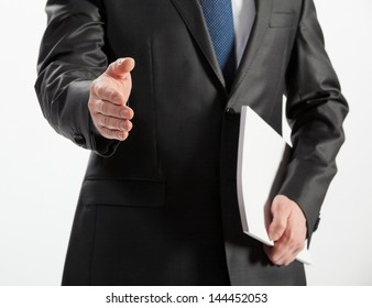 Businessman offering handshake to you isolated on white