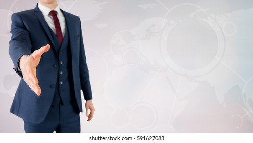 Businessman offering his hand for a handshake against world map on grey background