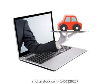 Businessman offering red car on silver tray out of a laptop screen, isolated on white