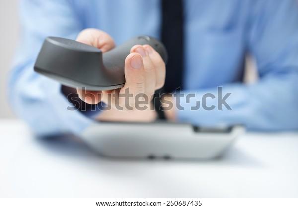 businessman is offering telephone handset