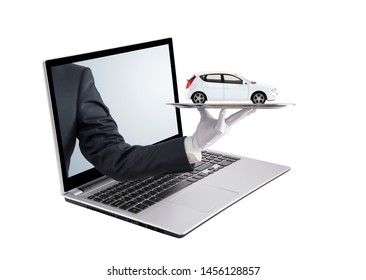 Businessman offering white car on silver tray out of a laptop screen, isolated on white