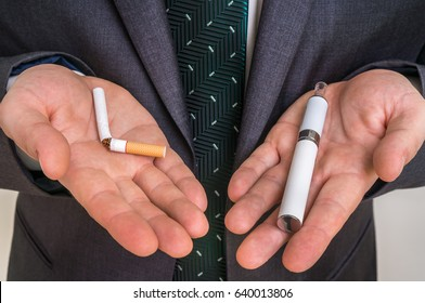 Businessman offers a choice between tobacco cigarette and electronic cigarette