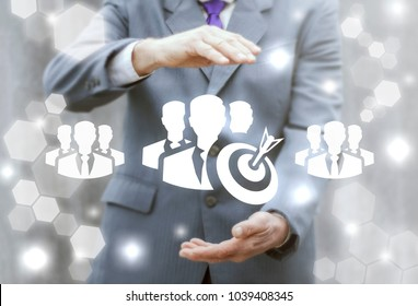 Businessman offers group man target icon on a virtual interface. Purpose Audience Business Team Work Success concept.