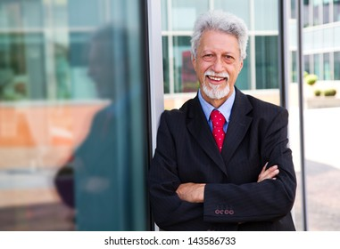 businessman  with an office building