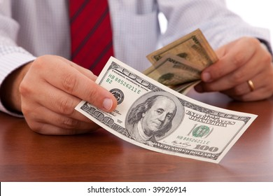 businessman at the office giving money