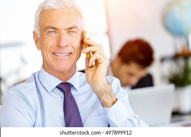 Businessman at the office with mobile phone
