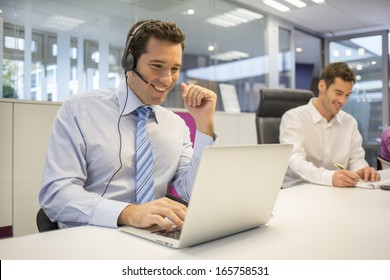 Businessman in the office on the phone with headset, Skype,FaceTime