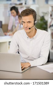 Businessman in the office on the phone, headset, Skype