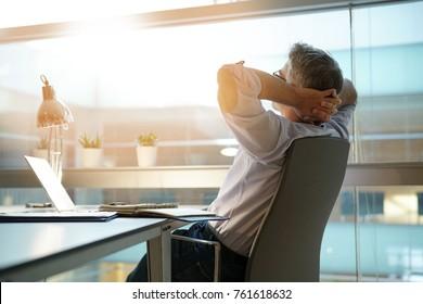 Businessman in office relaxing in chair - Shutterstock ID 761618632