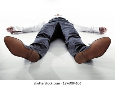 Businessman or office worker lying fainted on the floor